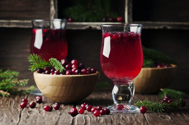 Fresh red cranberry juice on the vintage table