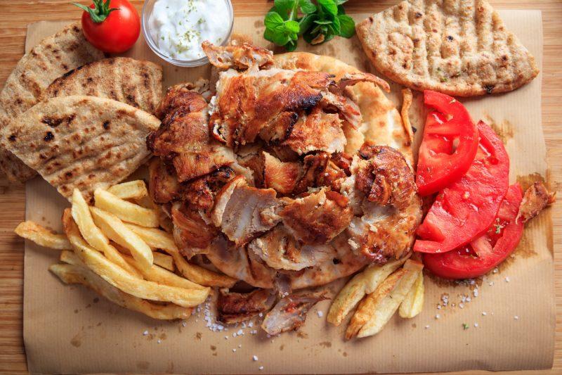 Greek gyros dish on baking paper - top view