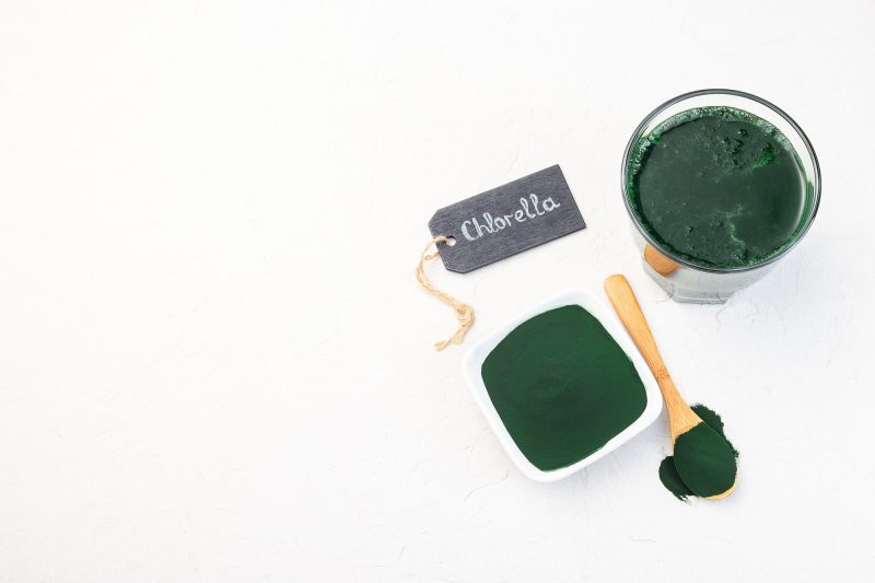 Superfood chlorella in powder and as drink, horizontal, copy space, top view