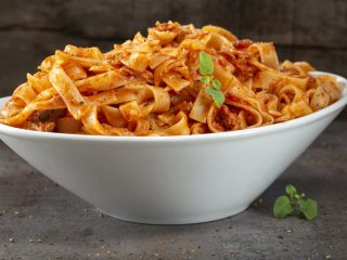 Tagliatelle pasta with tuna sauce and herbs