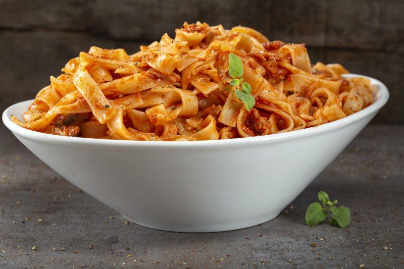 Tagliatelle pasta with tuna sauce and herbs