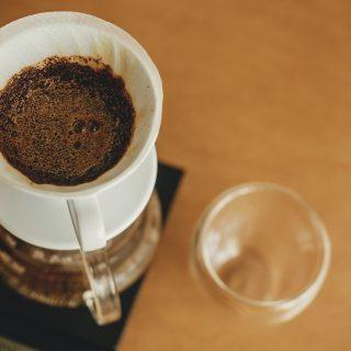 Drip coffee. Brewing aromatic fresh coffee in paper filter closeup
