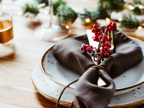 Festive table setting with winter decor. The concept of Thanksgiving or Christmas family dinner.