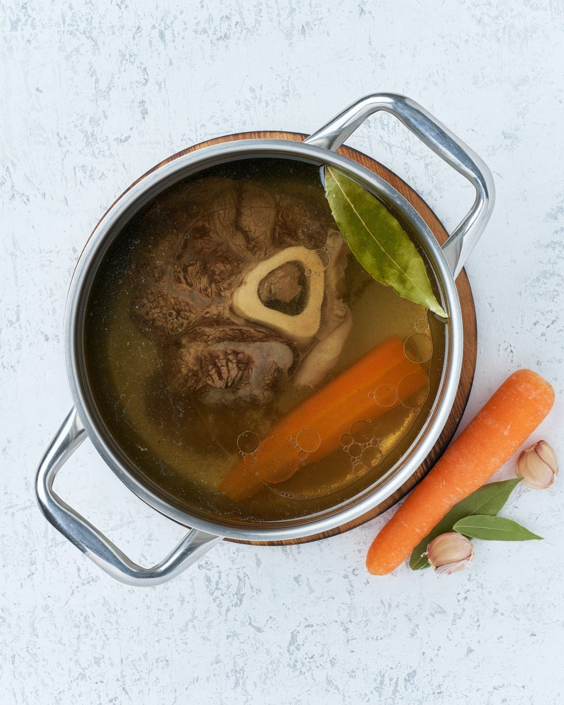 Paleo bone broth diet, beef meat soup. Low-carb food, keto recipe.