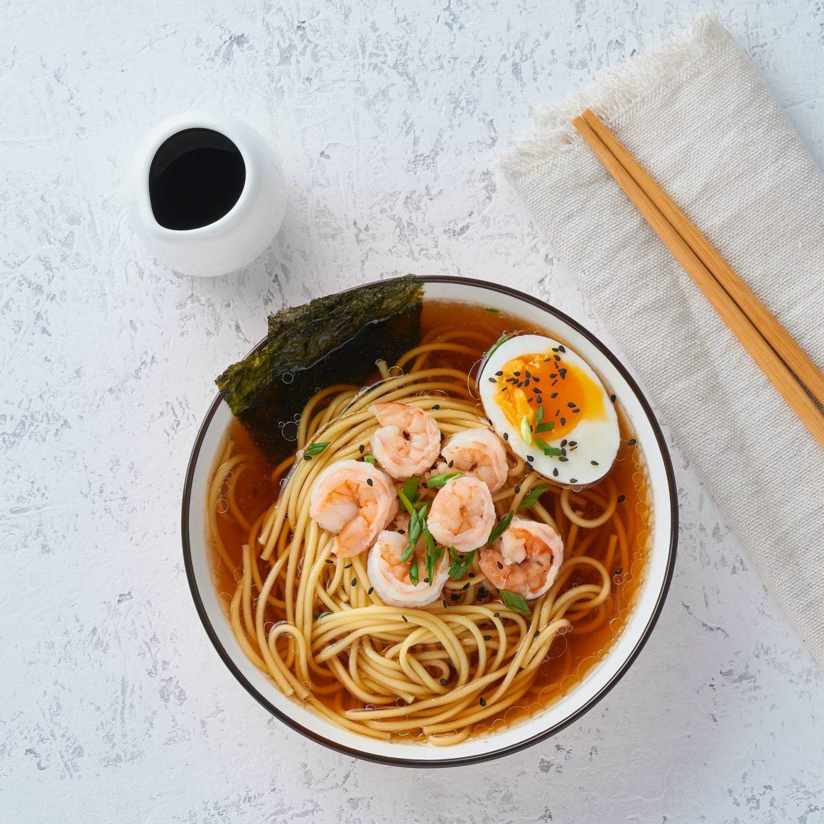 Asian soup with noodles, ramen with shrimps. Healthy Junk Food