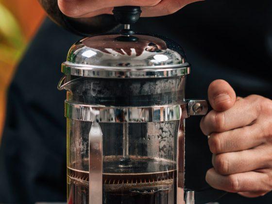 Barista Making French Press Coffee