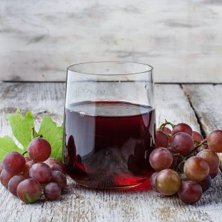 Glass of fresh grape juice