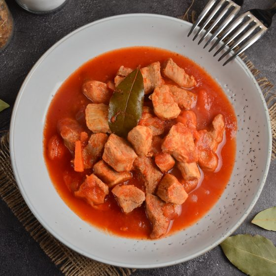 Pork stew with tomatoes