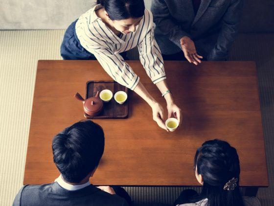 Japanese business people drinking tea