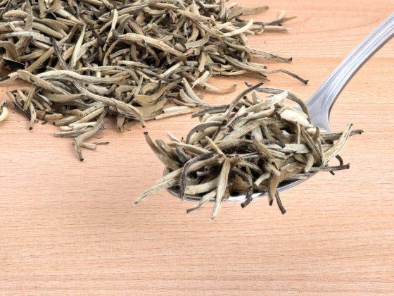Organic White Needle Tea on Cutting Board